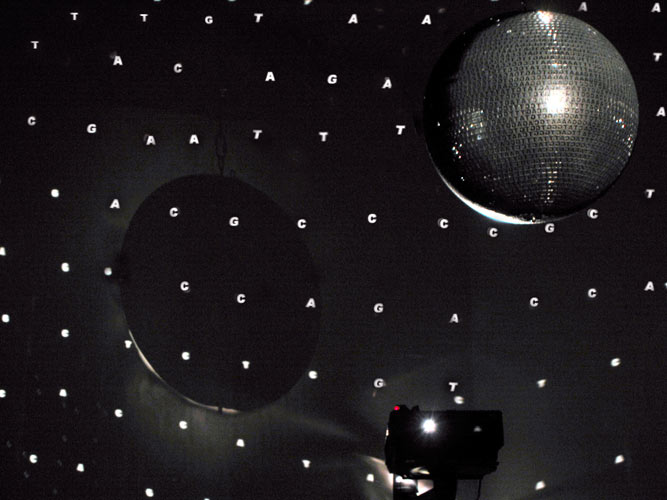 Veronika Witte, WENN ICH 'ICH' SAGE, LÜGE ICH, motorized mirror ball 70 cm, 10 LED moving messages 3 x 12 cm in objects, 2 slide projectors with hole lenses